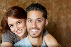 couple smiling with porcelain veneers