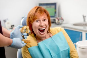 Do you know how we give patients dental implants in State College?
