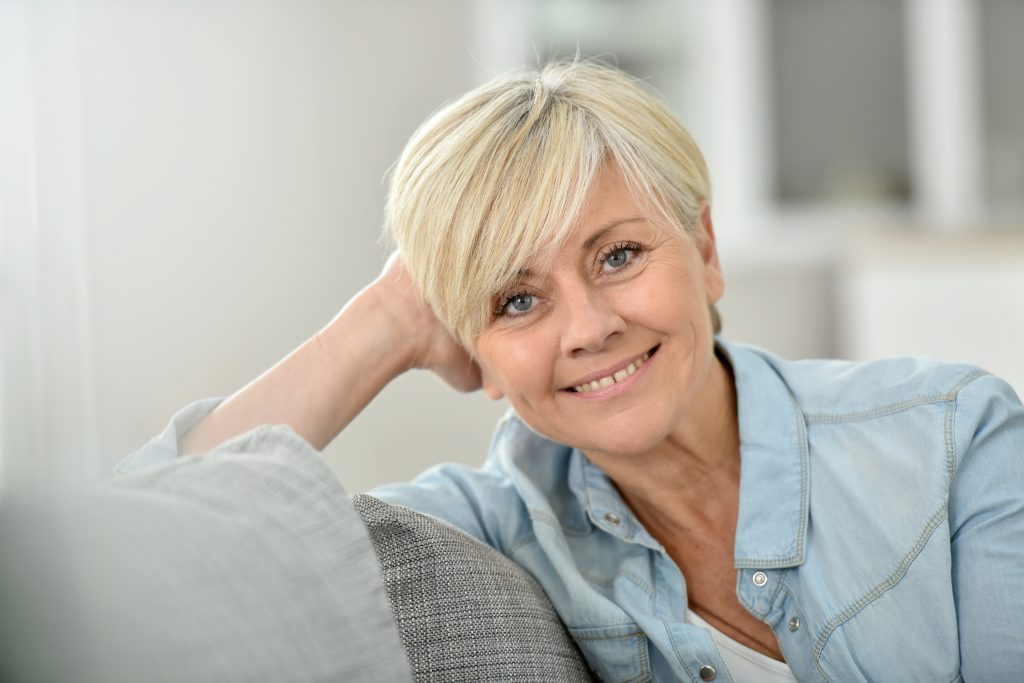 older woman smiling blonde hair